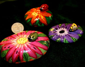 Hand Painted Rocks set of 6. 6 Flowers & Honey Bee, June bug, and a Lady bug. Flower rocks in this collection are painted on both sides.