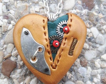 Made of polymer clay steampunk Heart Necklace.