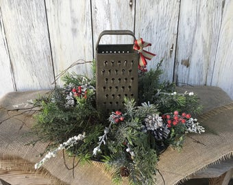 Christmas Centerpiece with Antique Grater on a Silver and Black Charger Plate Farmhouse Arrangement, Winter Arrangement, Winter Centerpiece
