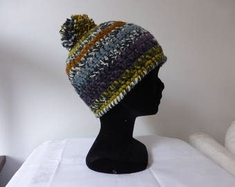 With hand crocheted Pompom Beanie