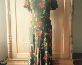beautiful early 1930s rayon green floral dress with flutter sleeves size medium