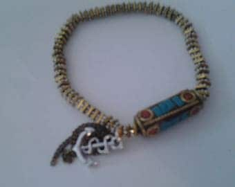 Bracelet with a multicolored totem pendant 00