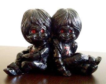 Creepy Children Statue