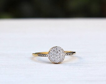 pad covered with cubic zirconia gold plated ring