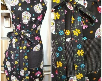 Adult Apron. Woman's apron. Colorful sugar glittery skulls and floral. Black and white polka dot pocket. Floral ties and frills