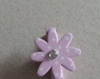 small wooden clothes pin pink with a fancy flower