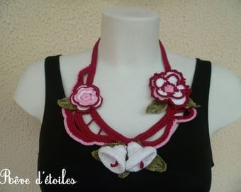 Textile necklace adorned with flowers and leaves