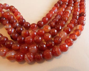 6 Tan/Red 8mms faceted, sparkling and banded agates.