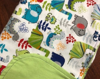 Flannel swaddle blanket - green dinosaurs