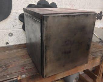 Unusual metal cabinet with handmade wooden top.