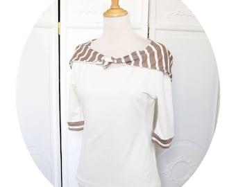 Top has hood in cream, three sleeve jersey quarter, ecru top has hood, sleeves three quarter ivory and beige top has scratches, ecru beige top