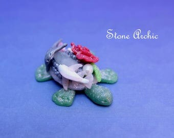 Turtle figurine with a rose quartz and a fresh water pearl.