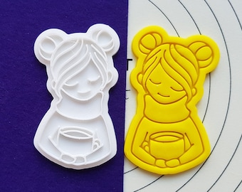Girl holding Coffee Cookie Cutter and Stamp