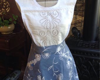 Daisy, Daisy!  Blue tablecloth apron with a bib from a vintage pillow sham, petal style skirt and bias trim.