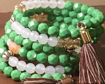 Green white and Citrine Coloured Wrap Around Coil Bracelet With Tassells.