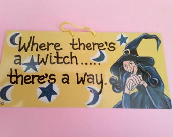 Comical hanging witch sign