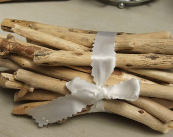 bundle of drift wood and satin bow
