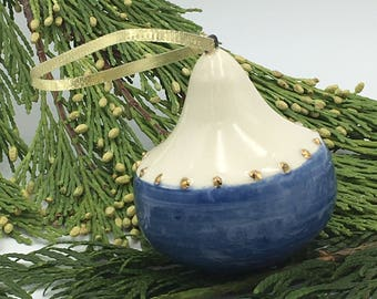 White & blue hand thrown ornament with gold dots