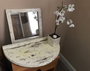 Hanging wall table mirror and flowers distressed wood