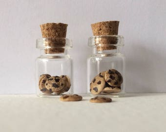 Miniature polymer clay cookie jars with loose cookies and cork stopper