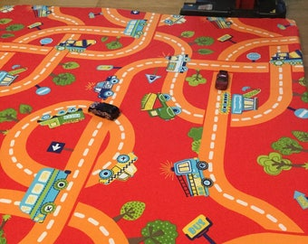 Red child rug, with two bus EnchDK traffic