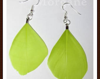 Round lime green feather earrings