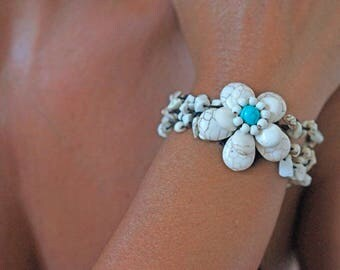 Female braided flower Coral white and turquoise bracelet