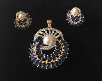 Beautiful gold plated American diamond (cubic zirconia ) and blue stone pendant set