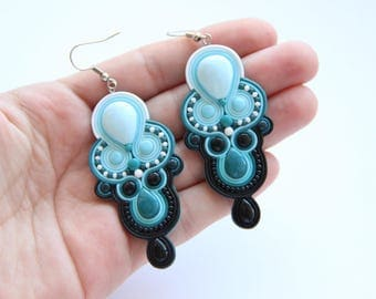 Handmade earrings are made of polymer clay. The earrings have color gradient and imitation of soutache.