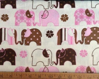 Flannel/Pink and brown elephants on off-white background cotton fabric