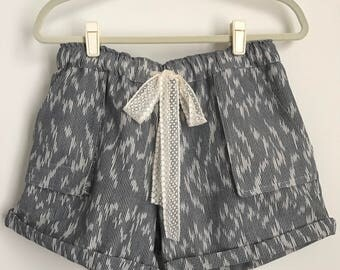 lace trim tie cotton ikat black & off white trouser shorts with patched pocket
