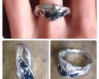UnEarthed sterling silver and blue rough sapphire twig ring.