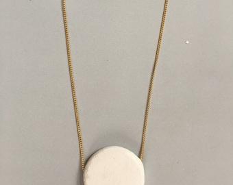 Minimal geometric clay necklace.