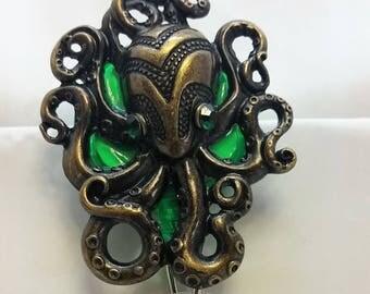Bronze and green octopus badge reel