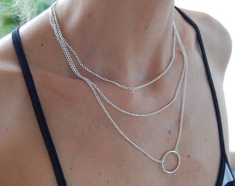 Delicate necklace with 3 silver chains and a ring