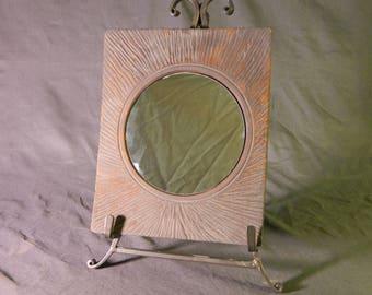 Hand turned mirror