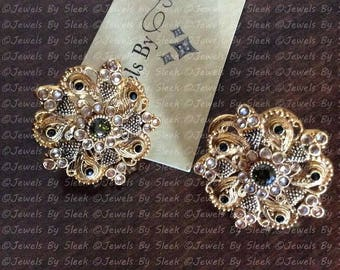 Kundan stud earrings in olive green zircon