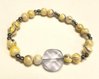 Yellow & silver swirl bead bracelet, stretchy