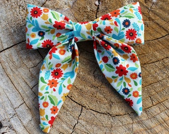 Sailor Bow in Multi Colored Blooms Patterned Fabric on a Nylon Band