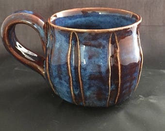 Pottery mug. Ceramic mug. Carved mug. Handcrafted pottery mug. Ceramic mug. Blue and brown mug. Textured mug. Coffee. Tea cup.