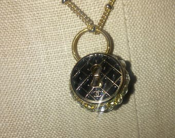 Chanel gold tone and rhinestone black keyhole pendant and gold tone chain
