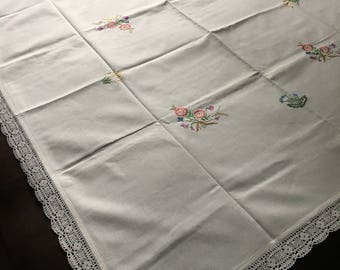 Vintage handmade tablecloth embroidered with flowers