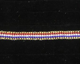 Beaded red white blue and gold bracelet