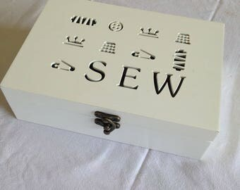 Stocked with small white wooden sewing box
