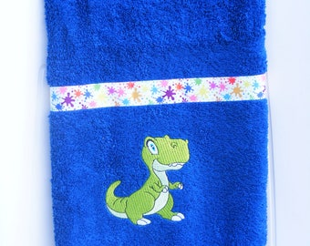 dark blue towel embroidered d a little dinosaur free personalization to the child's name