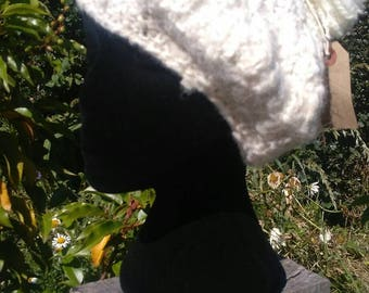 Full moon beret. Local teeswater fleece, handspun by me. Gleams like full moon. Timeless style plus a tassel on top.