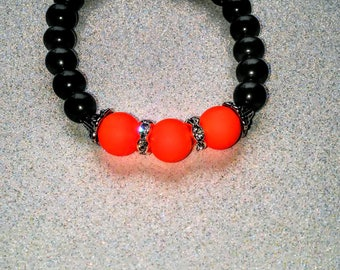 Neon orange, black, and silver bracelet