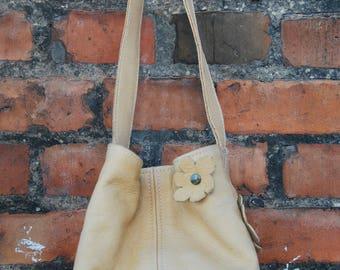Small handmade natural leather bag