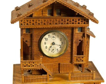 a black forest clock chalet with musical movement ca. 1910