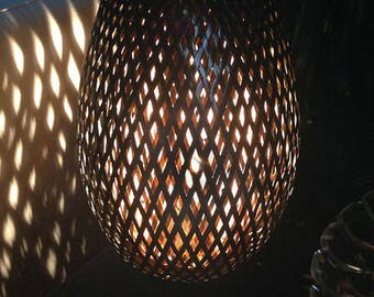 Lamp woven bamboo 35 cm. Black lacquered & dimmer.